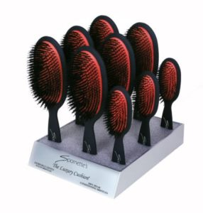 black hair brushes with red cushions in display stand Spornette Professional Brushes